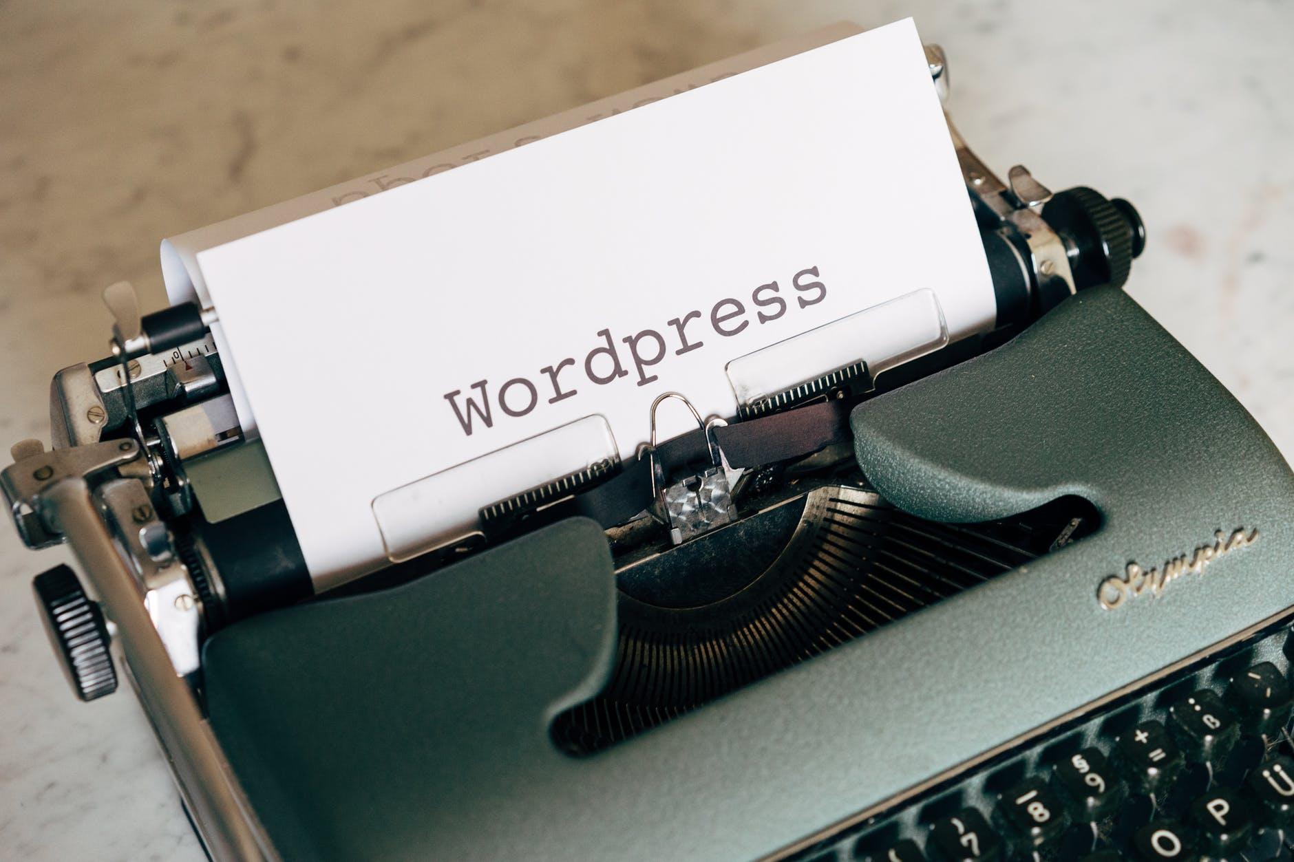 white printer paper on green typewriter